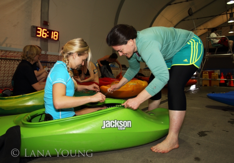 Joanne helping to outfit the kayak, one of the most important things to do ~ fit properly.